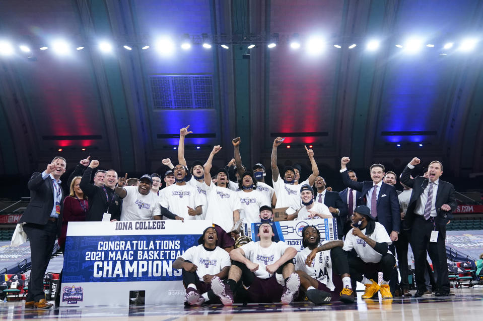 Iona players and personnel celebrate after winning an NCAA college basketball game against Fairfield during the finals of the Metro Atlantic Athletic Conference tournament, Saturday, March 13, 2021, in Atlantic City, N.J. (AP Photo/Matt Slocum)