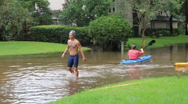 Regis Prograis (L) is shown in the aftermath of Hurricane Harvey. (Courtesy of Regis Prograis)