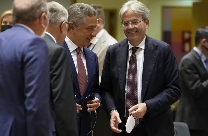 European Commissioner for Economy Paolo Gentiloni, second right, speaks with Fabio Panetta, Member of the Executive Board of the ECB, third left, during a meeting of the eurogroup finance ministers at the European Council building in Brussels on Monday, July 12, 2021. (AP Photo/Virginia Mayo)