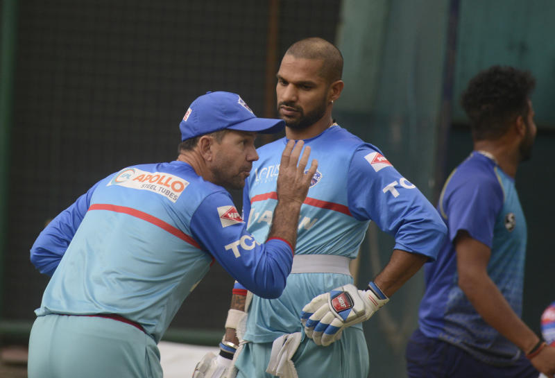 Shikhar Dhawan and Ricky Ponting talking during a training session for the Mumbai Indians.