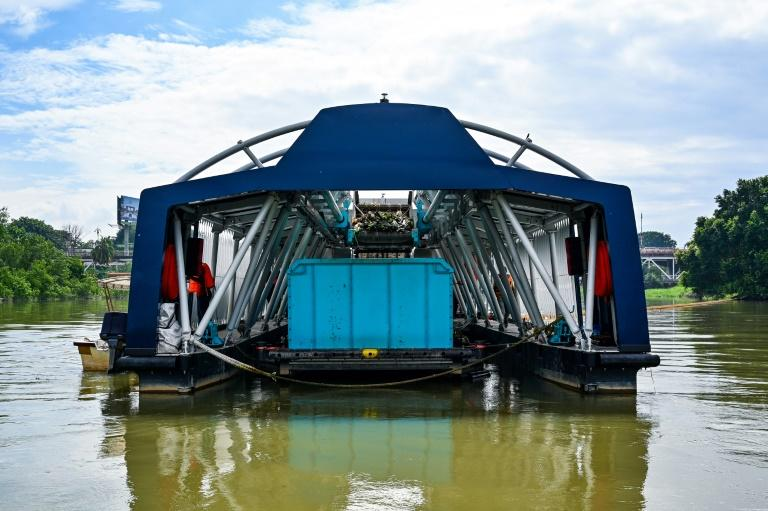 The Interceptor barge can collect up to 50 tons of waste a day (AFP Photo/Mohd RASFAN)