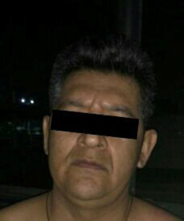 "Erick ""N"", suspected of being linked to the disappearance of 43 students of the Ayotzinapa teacher training college, is pictured after being detained"