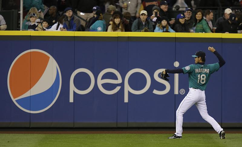 In this Friday, April 12, 2013, photo, Seattle Mariners starting pitcher Hisashi Iwakuma warms up next to a Pepsi advertisement before a baseball game against the Texas Rangers, in Seattle. PepsiCo Inc. reports quarterly financial results before the market opens on Thursday, April 18, 2013. (AP Photo/Ted S. Warren)