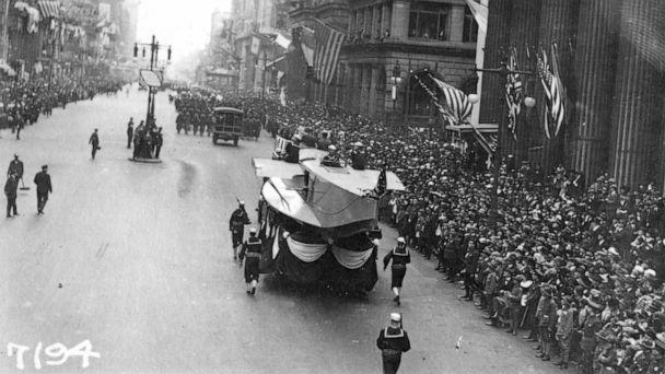 PHOTO: In this Sept. 28, 1918, photo provide by the U.S. Naval History and Heritage Command the Naval Aircraft Factory float moves south on Broad Street escorted by Sailors during the a parade meant to raise funds for the war effort, in Philadelphia. (U.S. Naval History and Heritage Command via AP)