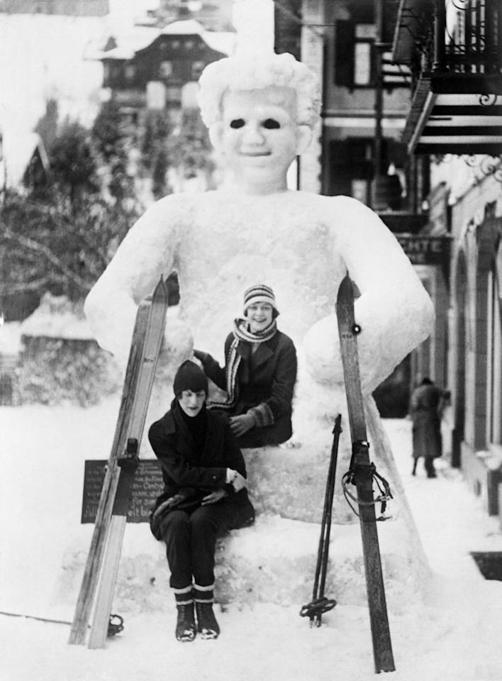 <p>The popular resort at <strong>St. Moritz, Switzerland</strong> hosted such stars as <strong>Brigitte Bardot </strong>and millionaire <strong>Gunther Sachs.</strong>  This all-too-real snowman is accompanied by a couple of smiling young women in September <strong>1929</strong>.</p>