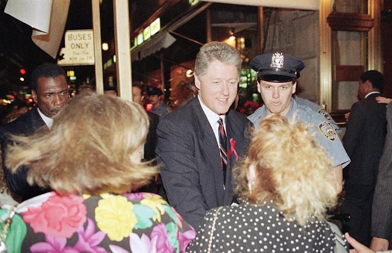 FILE - This July 16, 1992 file photo shows then Democratic presidential nominee Gov. Bill Clinton shaking hands with supporters as he arrives at the Hotel Inter-Continental in New York.  A new study shows that contrary to the idea that being president speeds up the aging process, many U.S. commanders in chief have lived longer than their peers. (AP Photo/Charles Rex Arbogast, file)