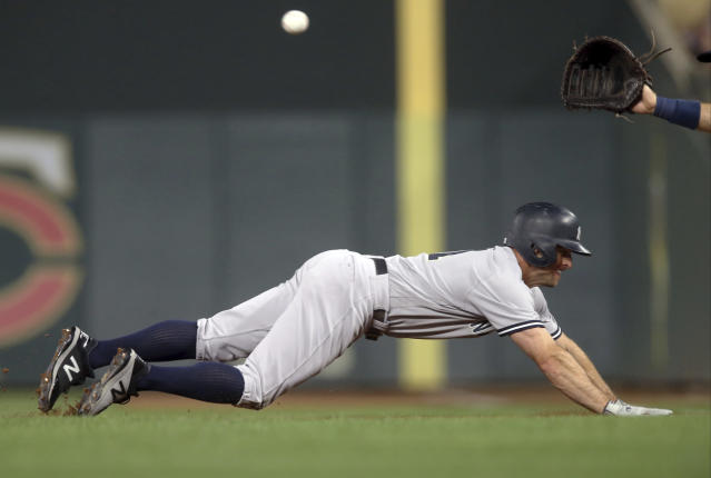 New York Yankees' Brett Gardner beats the pickoff attempt throw by Minnesota Twins pitcher Kyle Gibson in the fifth inning of a baseball game Monday, Sept. 10, 2018, in Minneapolis. (AP Photo/Jim Mone)