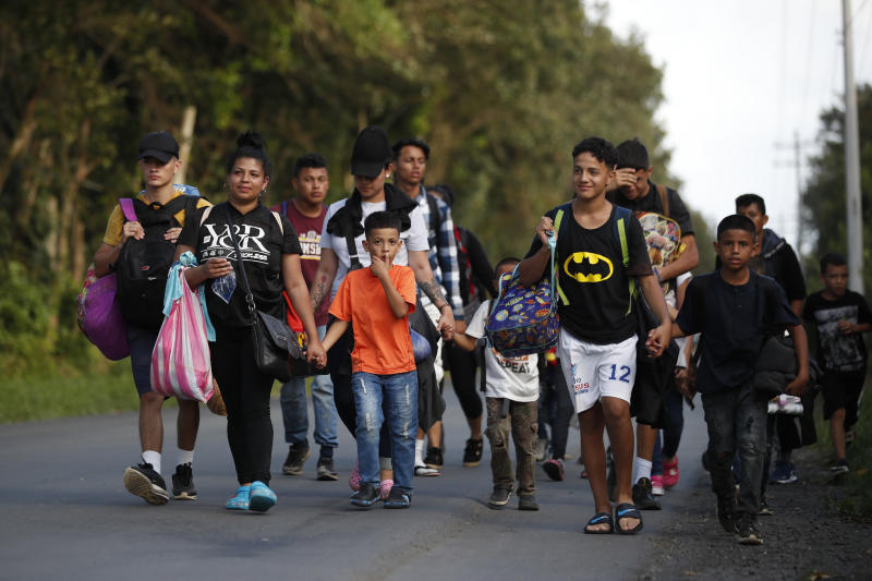 A group of migrants walks trying to make it to the United States, near El Cinchado, Guatemala, Wednesday, Jan. 15, 2020, on the border with Honduras. Hundreds of mainly Honduran migrants started walking and hitching rides from the city of San Pedro Sula and crossed the Guatemala border in a bid to form the kind of migrant caravan that reached the U.S. border in 2018. (AP Photo/Moises Castillo)