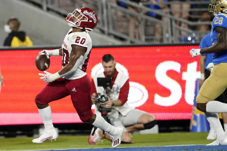 Fresno State running back Ronnie Rivers (20) celebrates his touchdown against UCLA during the first half of an NCAA college football game Saturday, Sept. 18, 2021, in Pasadena, Calif. (AP Photo/Marcio Jose Sanchez)