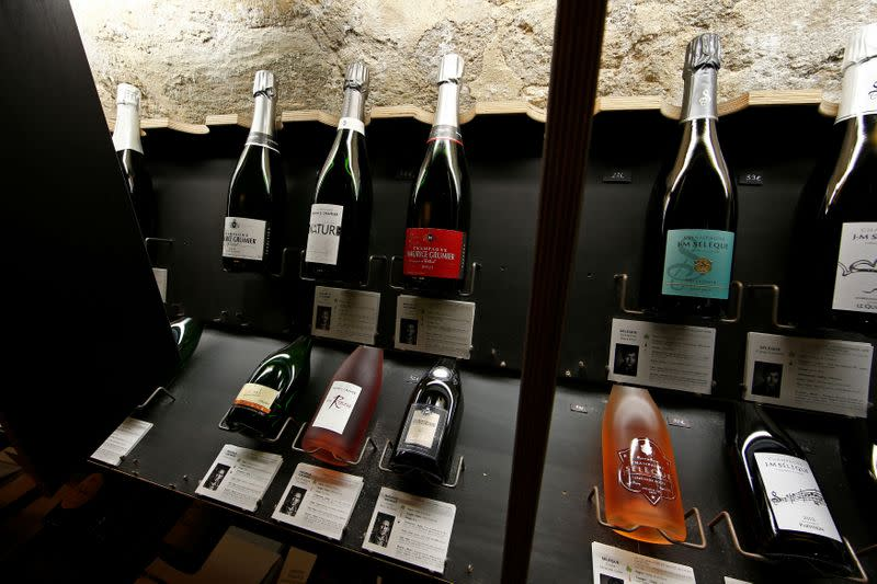 FILE PHOTO: Bottles of Champagne are displayed at Dilettantes wine shop in Paris