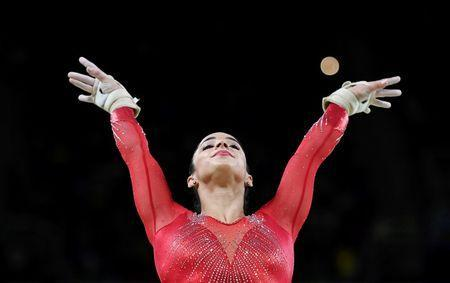 2016 Rio Olympics - Artistic Gymnastics - Final - Women's Individual All-Around Final - Rio Olympic Arena - Rio de Janeiro, Brazil - 11/08/2016. Alexandra Raisman (USA) of USA (Aly Raisman) competes on the vault during the women's individual all-around final. REUTERS/Dylan Martinez