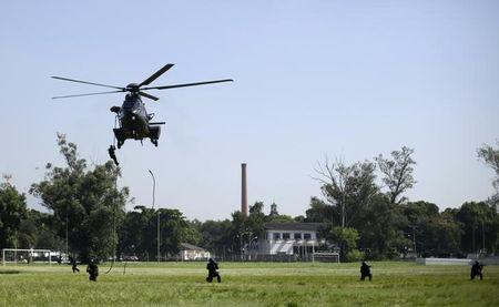 428f0f999aa A Brazilian Army soldier rappels down from a military helicopter as he  takes part in exercise