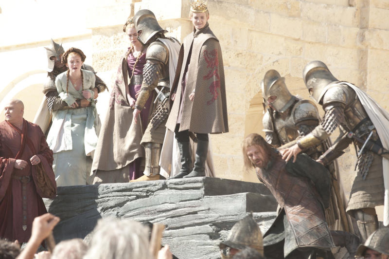 Jack Gleeson as Joffrey Baratheon and Sean Bean as Ned Stark in Game of Thrones' first season. (HBO)
