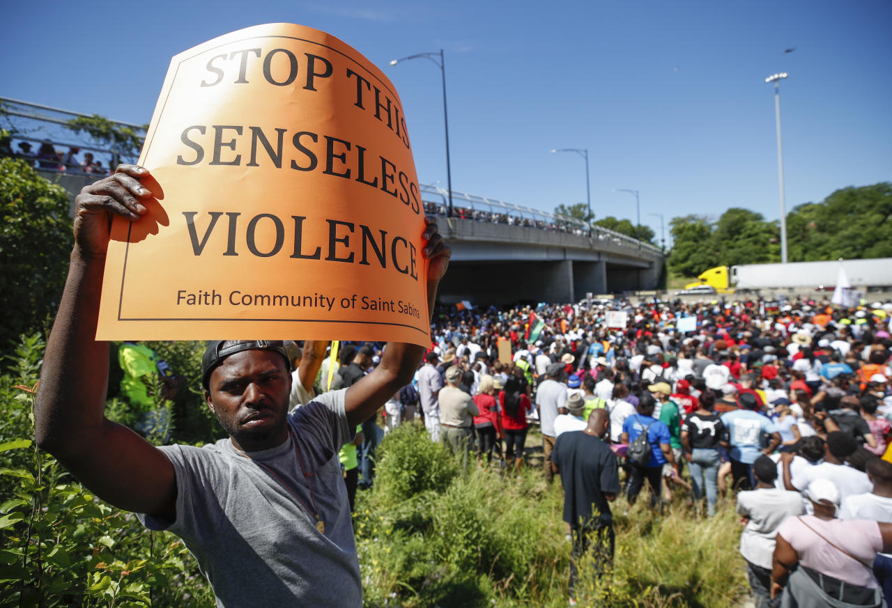 <p>An activist holds a sign during march along Chicago Dan Ryan Expressway to protest violence in the city on July 7, 2018 in Chicago, Ill. (Photo: Kamil Krzaczynski/Getty Images) </p>