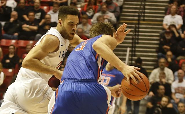 San Diego State forward JJ O'Brien puts on the full court press against Boise State forward Anthony Drmic during the first half of a NCAA college basketball game Wednesday, Jan. 8, 2014, in San Diego. (AP Photo/Lenny Ignelzi)
