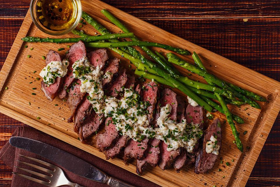 Serve asparagus with meat such as steak or pork. Top the meat with a peppercorn or blue cheese sauce. (Getty Image)