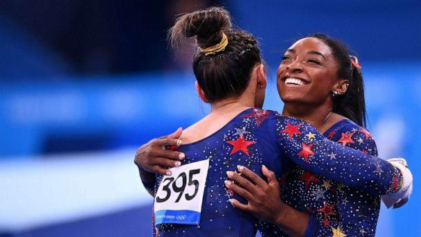 PHOTO: Sunisa Lee and Simone Biles, of the United States, hug each other during competition at the Ariake Gymnastics Centre, July 25, 25, 2021, in Tokyo, Japan. (Dylan Martinez/Reuters)