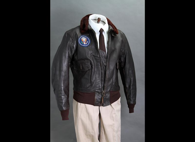 FILE - This 2012 file photo provided by John McInnis Auctioneers shows late President John F. Kennedy's Air Force One leather bomber jacket, which sold for $570,000 at an auction on Sunday, Feb. 17, 2013. The jacket is part of a collection of John F. Kennedy memorabilia from the family of David Powers, a former special assistant to the president, that fetched almost $2 million at Sunday's auction at John McInnis Auctioneers in Amesbury, Mass. (AP Photo/John McInnis Auctioneers, Matthew Bourgeois, File)