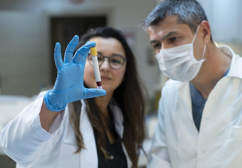 Female and male doctors analyzing medical samples in a lab