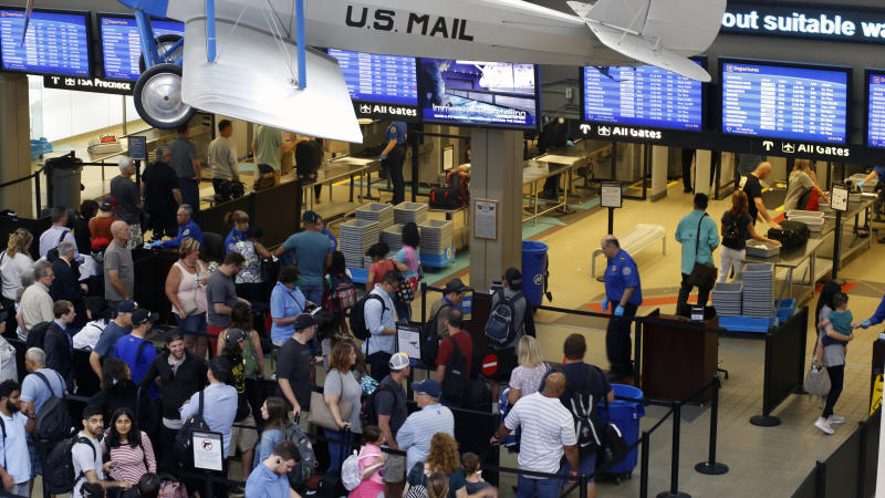 In this June 9, 2019, file photo, travelers make their way through a TSA security checkpoint in Pittsburgh International's Landside terminal in Imperial, Pa. The Transportation Security Administration said Thursday, July 11, 2019, that its officers screened 2,795,014 passengers and airline crew members on Sunday, July 7, barely beating a record set just five weeks earlier, over the Memorial Day weekend. (AP Photo/Gene J. Puskar, File)