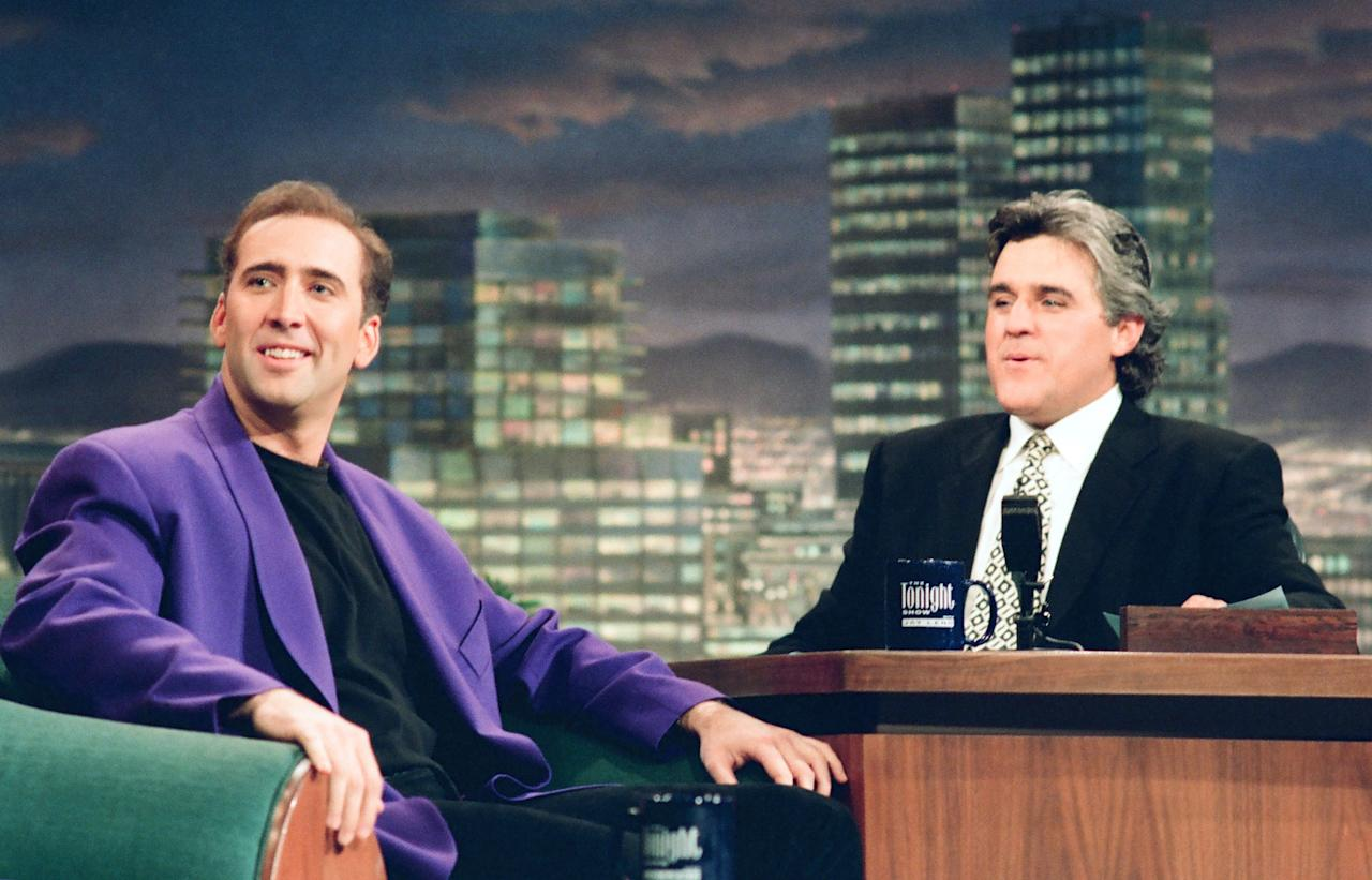 THE TONIGHT SHOW WITH JAY LENO -- Episode 517 -- Pictured: (l-r) Actor Nicolas Cage during an interview with host Jay Leno on August 11, 1994 -- (Photo by: Margaret Norton/NBC/NBCU Photo Bank via Getty Images)