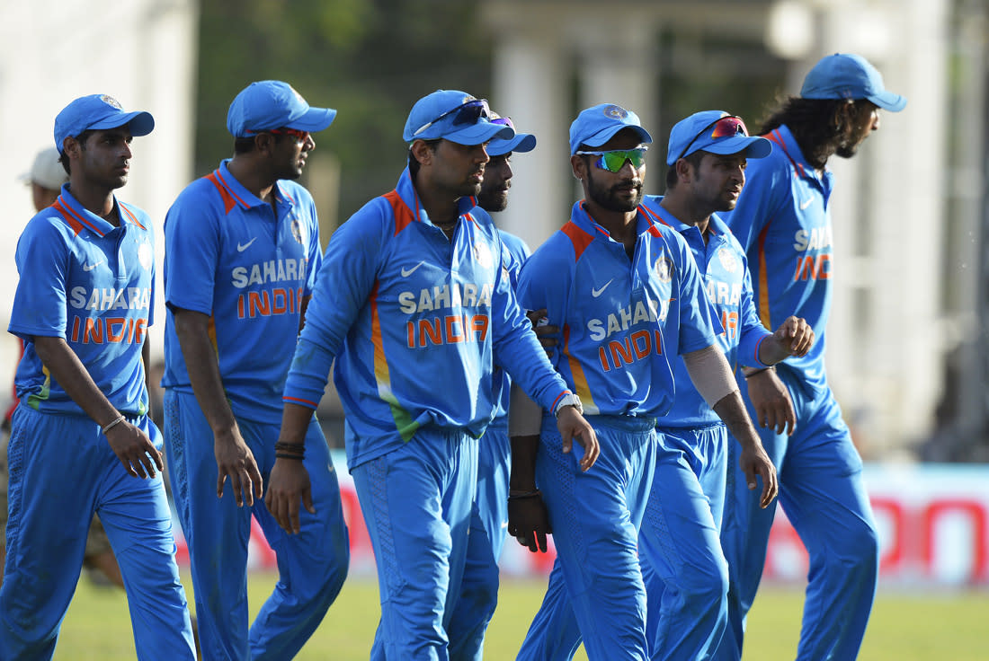 Indian cricketers leave the field after being defeated in the second match of the Tri-Nation series between Indian and West Indies at the Sabina Park stadium in Kingston on June 30, 2013. West Indies defeated India by 1 wicket. AFP PHOTO/Jewel Samad