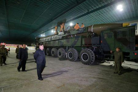 FILE PHOTO: North Korean leader Kim Jong Un inspects the intercontinental ballistic missile Hwasong-14 in this undated photo released by KCNA