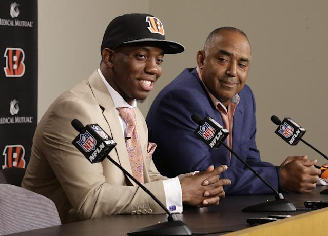 Cincinnati Bengals first round draft pick Darqueze Dennard, a cornerback out of Michigan State, speaks at a news conference with head coach Marvin Lewis, right, Saturday, May 10, 2014, at the NFL football team's stadium in Cincinnati. (AP Photo/Al Behrman)