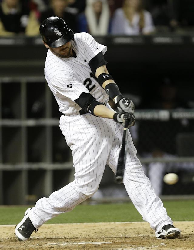 Chicago White Sox's Tyler Flowers hits a two-run single against the Tampa Bay Rays during the fourth inning of a baseball game in Chicago on Friday, April 25, 2014. (AP Photo/Nam Y. Huh)