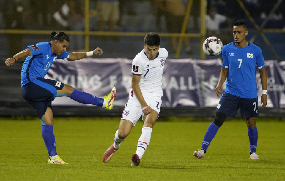 El Salvador's Alex Larin, left, and United States' Gio Reyna, fight for the ball during a qualifying soccer match for the FIFA World Cup Qatar 2022 at Cuscatlan stadium in San Salvador, El Salvador, Thursday, Sept. 2, 2021. (AP Photo/Moises Castillo)