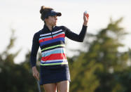 Gaby Lopez, of Mexico, waves to the gallery after making a birdie on the second hole during the second round of the LPGA Volunteers of America Classic golf tournament in The Colony, Texas, Friday, July 2, 2021. (AP Photo/Ray Carlin)