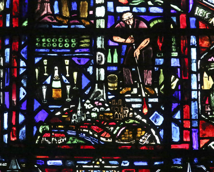 "In this Thursday, Oct. 17, 2013 photo, a stained glass of the Notre-Dame Cathedral of Reims depicts how to make Champagne in Reims, eastern France. Many champagne successes began with the tragedy-tinged stories of widows, or ""veuves"", women who turned their husbands untimely, and sometimes mysterious, deaths into a springboards to build empires from Reims. The taste, the look, and even the shape of the bottles sold around the world today reflect their feminine touch. (AP Photo/Remy de la Mauviniere)"