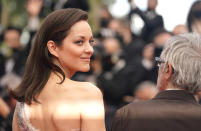 Marion Cotillard poses for photographers upon arrival at the premiere of the film 'Annette' and the opening ceremony of the 74th international film festival, Cannes, southern France, Tuesday, July 6, 2021. (AP Photo/Brynn Anderson)
