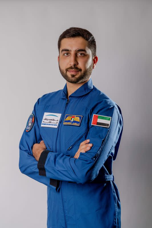 Emirati national Mohammad al-Mulla, selected to train as an astronaut, poses for a photo