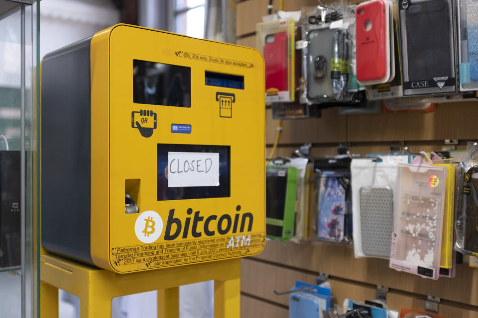 An ATM that can be used to exchange regular currency for Bitcoin stands faulty in a market stall in Leeds, UK