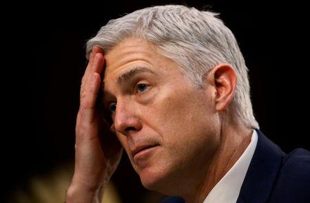 FILE PHOTO: U.S. Supreme Court nominee judge Neil Gorsuch listens to a question as he testifies during the third day of his Senate Judiciary Committee confirmation hearing on Capitol Hill in Washington, U.S., March 22, 2017. REUTERS/Jim Bourg/File Photo