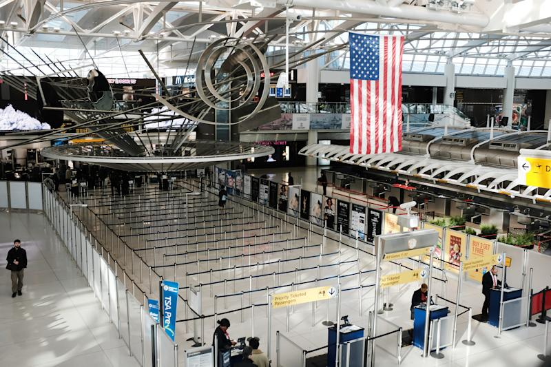 A sparse international departures terminal at John F. Kennedy International Airport in New York City on March 7. Days later, as concerns over the coronavirus grew, President Trump announced restrictions on travelers from Europe. | Spencer Platt—Getty Images