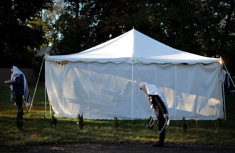 "Orthodox Jews gather for ""Hoshanot prayers"" as part of their Sukkot observance on neighborhood lawn in Monsey New York"