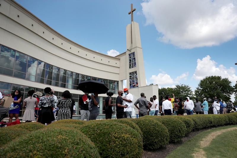 Image: Mourners wait on line for the viewing of George Floyd at he Fountain of Praise Church in Houston on June 8, 2020. (Joe Raedle / Getty Images)