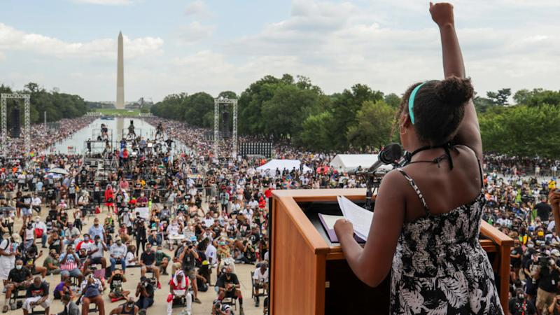 Victims' families decry 'two systems of justice' at Washington anti-racism march