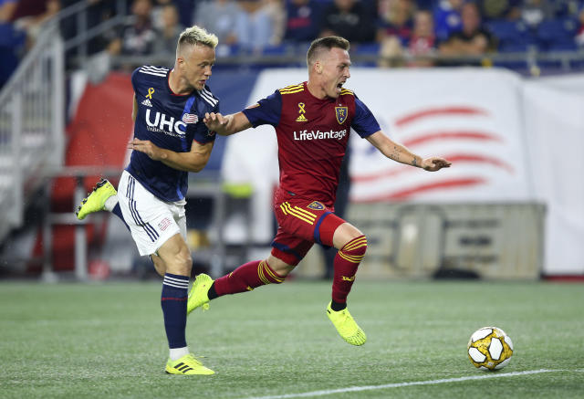 Real Salt Lake forward Corey Baird, right, is defended by New England Revolution defender Antonio Mlinar Delamea, left, during the first half of an MLS soccer match at Gillette Stadium, Saturday, Sept. 21, 2019, in Foxborough, Mass. (AP Photo/Stew Milne)