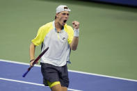 Denis Shapovalov, of Canada, reacts after winning the third set against David Goffin, of Belgium, during the fourth round of the US Open tennis championships, Sunday, Sept. 6, 2020, in New York. (AP Photo/Frank Franklin II)