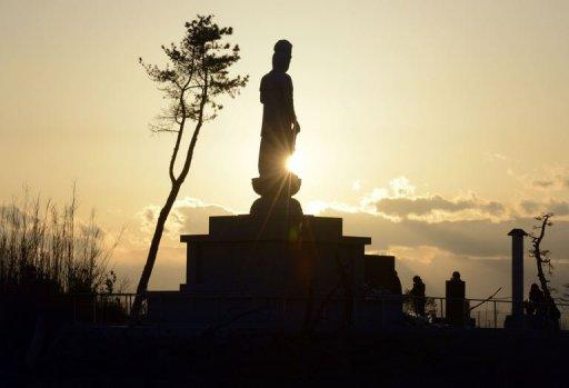 """<p>A Buddhist statue recently built in honour of tsunami victims is shown in Sendai, Miyagi Prefecture on March 11, 2013 on the second anniversary of the March 11, 2011 earthquake and tsunami disaster. Japan said Tuesday it was """"disappointing"""" China did not send anyone to a ceremony marking the second anniversary, in the latest sign of deteriorating ties between the two countries.</p>"""