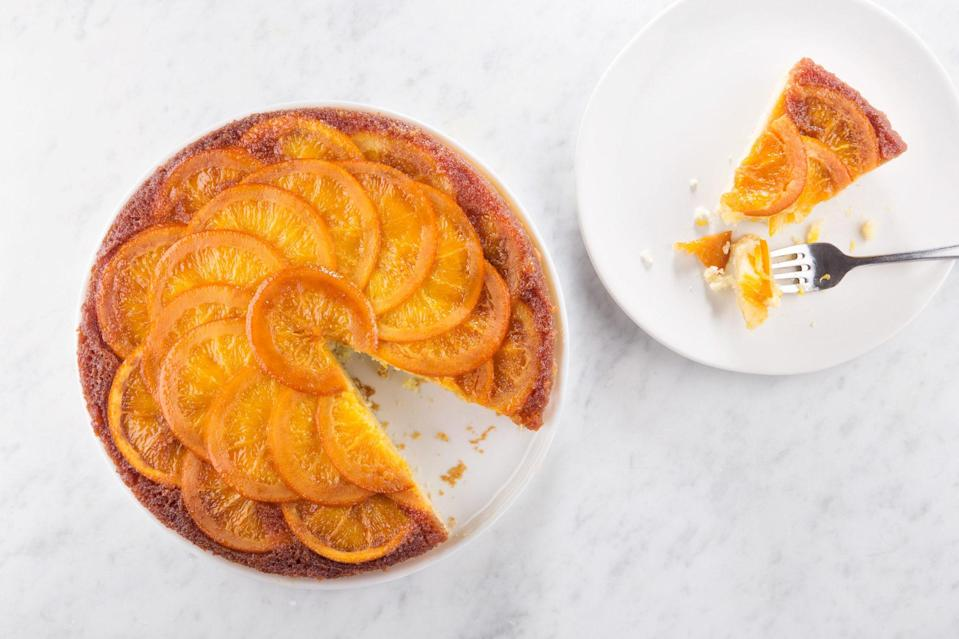 "This Easter recipe traces a familiar path: Slice fruit and nestle it in some caramel, pour cake batter over the top, bake, and unmold. When you flip over the cake, you'll find it's topped with delicious candied orange slices and citrusy caramel. <a href=""https://www.epicurious.com/recipes/food/views/orange-upside-down-cake-51264670?mbid=synd_yahoo_rss"" rel=""nofollow noopener"" target=""_blank"" data-ylk=""slk:See recipe."" class=""link rapid-noclick-resp"">See recipe.</a>"