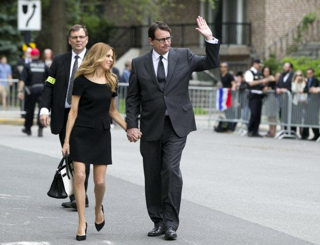 Julie Snyder and Pierre Karl Peladeau arrive for the funeral of former Quebec premier Jacques Parizeau at Saint-Germain-D'Outremont Church in Montreal on June 9, 2015.