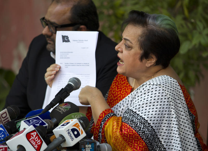 Shireen Mazari, information secretary of the Pakistan Tehreek-e-Insaf party, shows a document during a news conference in Islamabad, Pakistan, Wednesday, Nov. 27, 2013. A political party opposed to U.S. drone attacks in Pakistan revealed what it said was the name of the top CIA spy in the country on Wednesday and called for him and the head of the agency to be tried for a recent missile strike. Pakistani police and intelligence officials have said the attack on an Islamic seminary in Khyber Pakhtunkhwa's Hangu district on Nov. 21 killed five people. (AP Photo/B.K. Bangash)