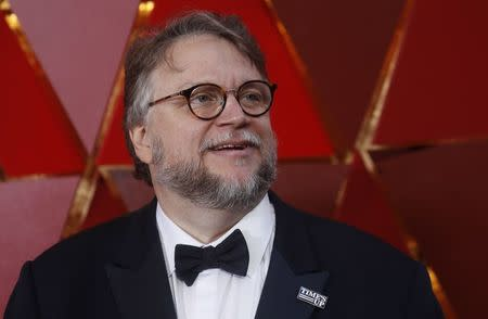 90th Academy Awards - Oscars Arrivals - Hollywood, California, U.S., 04/03/2018 - Best Director Nominee Guillermo del Toro wears a Times Up pin. REUTERS/Carlo Allegri