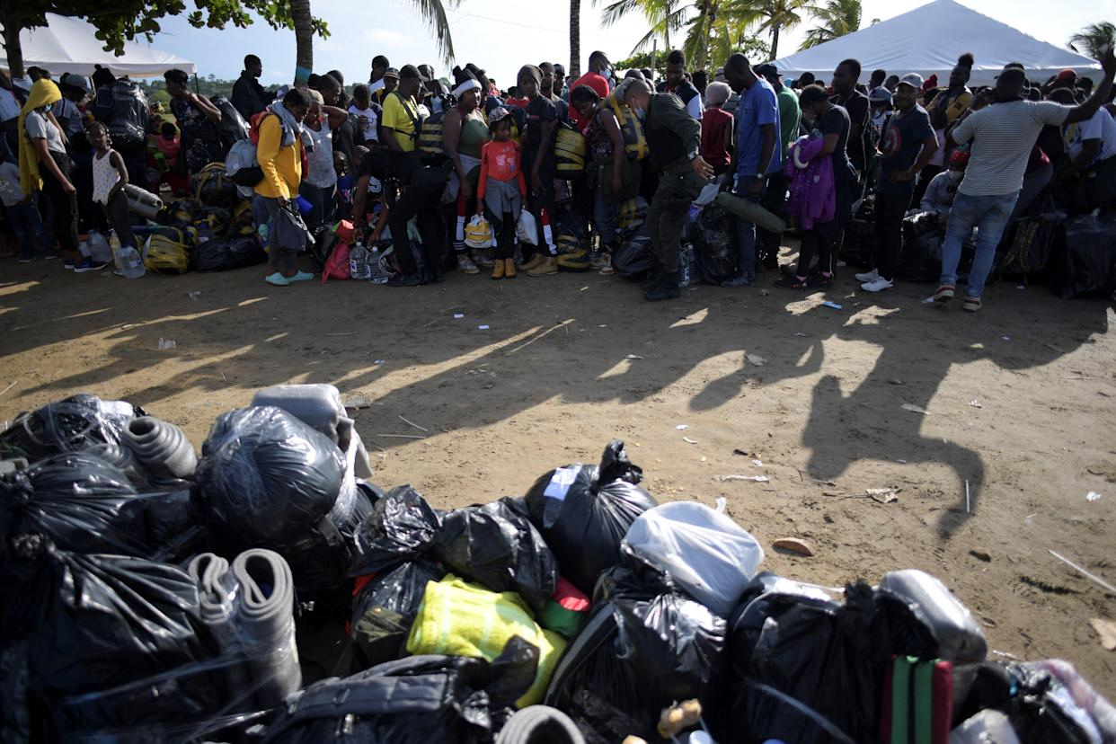 Haitian migrants wait in line to board a boat to navigate to the border with Panama in Necocli, Colombia, on September 23, 2021. (Raul Arboleda/AFP via Getty Images)