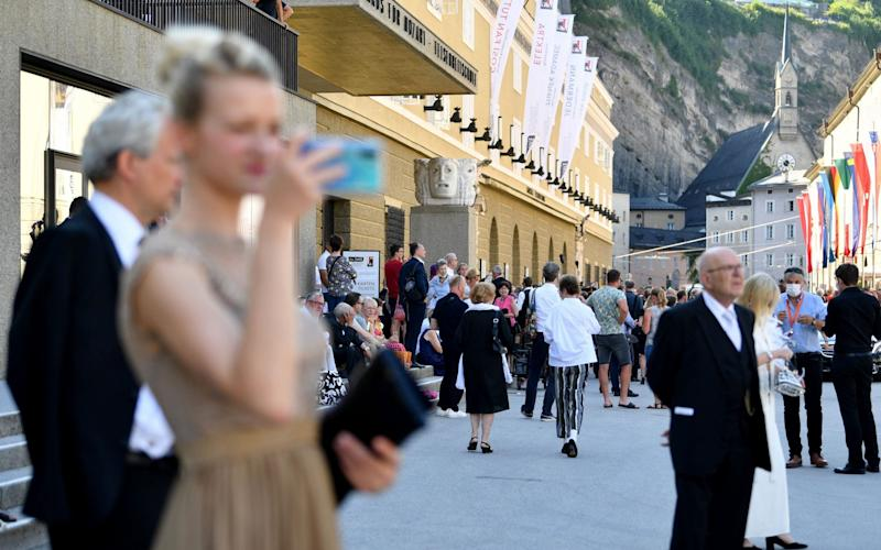 """Visitors and onlookers are seen in Hofstallgasse street prior to the performance of """"Elektra"""" - Barbara Gindl/AFP"""