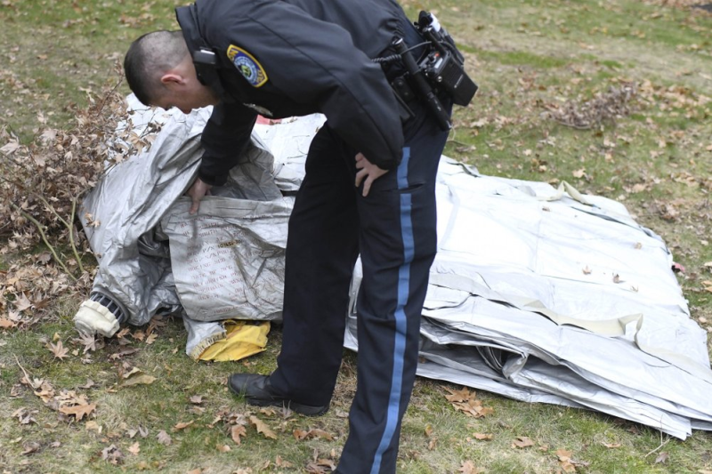 Police in Boston inspecting an inflatable slide that fell from a Delta Air Lines flight in Boston, US.